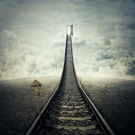 Railroad of opportunity along a cracked desert ground, going up as a staircase to a opened door in the sky, road to heaven symbol. Success plan, business concept