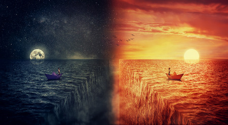 Conceptual view of two worlds collide, as a lost man, in a paper boat, sailing in the middle of the ocean try to find himself in a another world, alternate reality. Parallel universe, multiverse fiction theory. Adventure and journey concept.