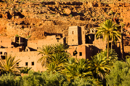 The ancient moroccan town near Tinghir with old kasbahs and high Atlas mountains in background, Tinghir, Morocco in Africa