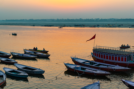 Photo for Sunrise at Ganga River with people ride a boats, Varanasi, India - Royalty Free Image