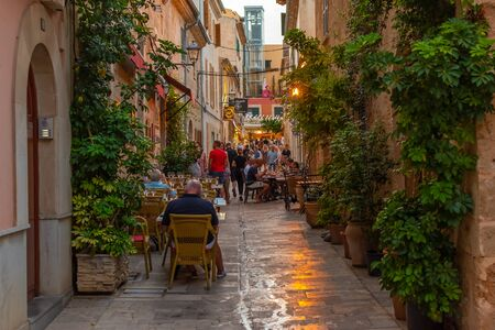 Photo pour Night or blue hour view of a narrow street in the old town of Alcudia, Mallorca, Spain - image libre de droit