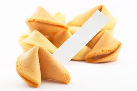 Chinese fortune cookies, on white background, with a white piece of paper for entering own text/fortune, shallow depth of field
