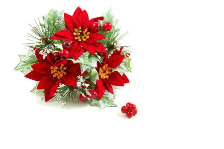 Christmas wreath, poinsettia flowers, leaves and berries on a snowy setup. Horizontal, landscape orientation