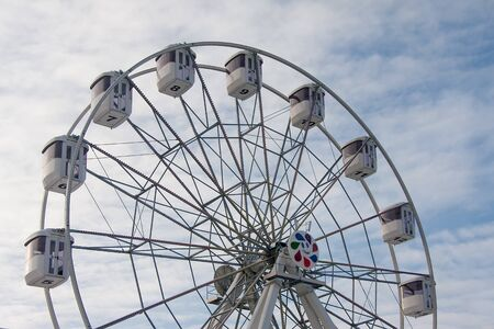 Photo for Ferris wheel without people in front of blue sky. - Royalty Free Image