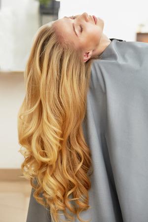 Long Blonde Hair Woman in hair salon