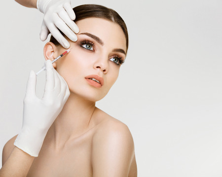 Photo for Beautiful woman gets botox injections - Royalty Free Image