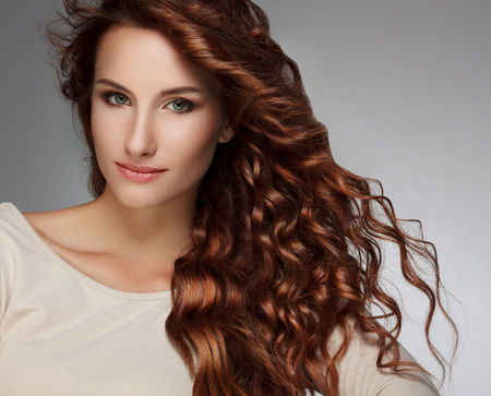 Foto de Beautiful Woman with Curly Long Hair - Imagen libre de derechos
