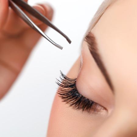 Photo pour Woman eye with long eyelashes. Eyelash extension. Eyebrow - image libre de droit