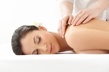 Photo pour Massage. Close-up of a Beautiful Woman Getting Spa Treatment - image libre de droit