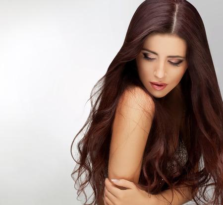 Photo pour Long Hair. Portrait of Beautiful  Woman with Long Brown Hair. Good quality retouching. - image libre de droit