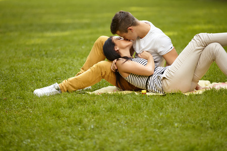 Photo for Kissing couple. Portrait of young caucasian couple kissing - Royalty Free Image