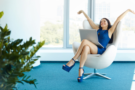Business woman celebrates successful deal at office. Bussiness People