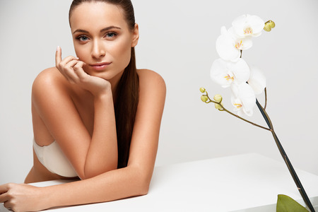 Photo for Spa Woman. Beautiful Girl Touching Her Face. Perfect Skin. Skincare. Wellness advertising - Royalty Free Image