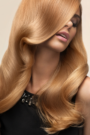 Blond hair. Portrait of beautiful Blonde with Long Wavy Hair. High quality image.