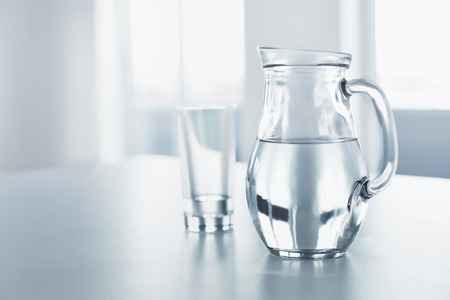 Photo pour Water. Health And Diet Concept. Drinks. Woman's Hand Holding Glass Of Pure Water. Healthy Eating, Lifestyle. Healthcare And Beauty. - image libre de droit