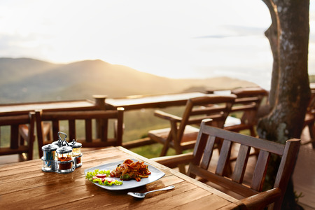 Photo pour Food. Dinner In Thai Restaurant Outdoors. Healthy Organic Meal On Wooden Table. Beautiful Landscape, View, Hills On Background. Travel To Luxury Tropical Resort. Thailand Vacations. Lifestyle. - image libre de droit