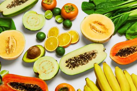 Foto für Healthy Nutrition. Fresh Organic Vegetables And Fruits ( Bok Choy, Papaya, Salad, Persimmon, Avocado, Lime, Bananas , Melon, Guava, Oranges ). Food Ingredients Background. Vegetarian, Vitamins Concept - Lizenzfreies Bild