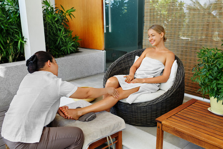 Spa Woman Body Care. Aromatherapy Oil Leg Massage. Masseur Massaging Girl Long Legs Outside In Beauty Salon Garden Terrace. Relaxing Recreational Skincare Treatment, Therapy Concept. Healthy Lifestyle
