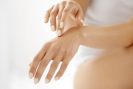 Photo pour Hand Skin Care. Closeup Of Beautiful Female Hands With Natural Manicure Nails. Close Up Of Woman's Hand Touching Her Soft Silky Healthy Skin. Beauty And Health, Body Care Concept. - image libre de droit