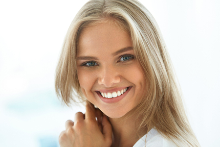 Photo for Beautiful Woman Smiling. Portrait Of Attractive Happy Healthy Girl With Perfect Smile, White Teeth, Blonde Hair And Fresh Face Smiling Indoors. Beauty And Health Concept. High Resolution Image - Royalty Free Image