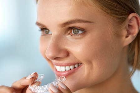 Orthodontics Closeup Of Beautiful Happy Smiling Woman With White Smile Straight Teeth Holding Whitening Tray Invisible Braces Teeth Trainer Dental Treatment Health Concept High Resolution Image Royalty Free Images Photos And Pictures