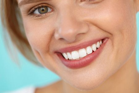 Photo pour Beautiful Smile. Closeup Of Beautiful Happy Smiling Woman With White Teeth And Fresh Face. Beauty Girl With Cosmetic Lip Balm On Her Full Lips. Dental Health, Lip Care Concept. High Resolution Image - image libre de droit