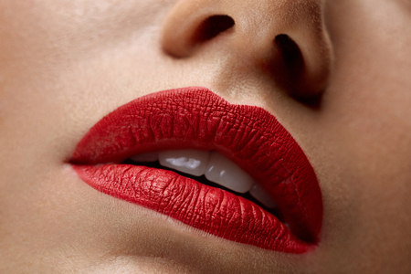 Woman Lips With Red Lipstick. Closeup Beautiful Young Sexy Girl's Mouth With Cosmetic Lipstick On Plump Full Lips. Female With Professional Lip Makeup. Beauty Cosmetics Concept. High Resolution Imageの写真素材