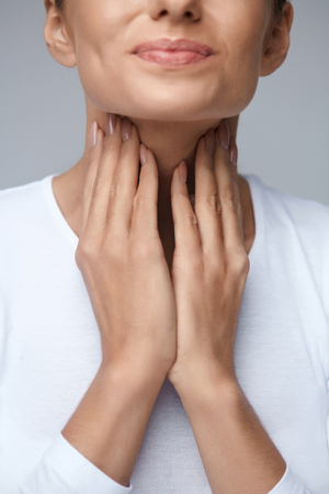 Sore Throat. Closeup Of Beautiful Young Woman Hands Touching Her Ill Neck. Close-up Of Girl Suffering From Throat Pain, Painful Swallowing. Illness, Medicine And Health Care Concept. High Resolution
