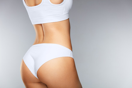 Photo for Body Care. Beautiful Slim Woman Back With Tight Firm Buttocks, Sexy Butt, Healthy Soft Skin In White Bikini Panties. Closeup Girl With Perfect Body Shape In Underwear. Beauty Concept. High Resolution - Royalty Free Image