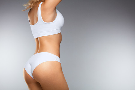 Photo for Beautiful Woman Body In Shape. ?loseup Healthy Girl With Fit Slim Body, Soft Skin And Firm Buttocks, Hips In White Bikini Panties. Female With Sexy Back, Tight Big Butt In Underwear. High Resolution - Royalty Free Image