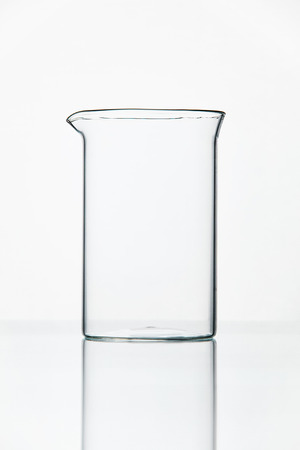 Laboratory Supplies. Transparent Glass On Table On White Background. High Resolution.