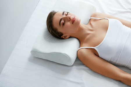 Photo pour Healthy Sleep. Woman Sleeping On White Orthopedic Pillow In Bed. High Resolution. - image libre de droit