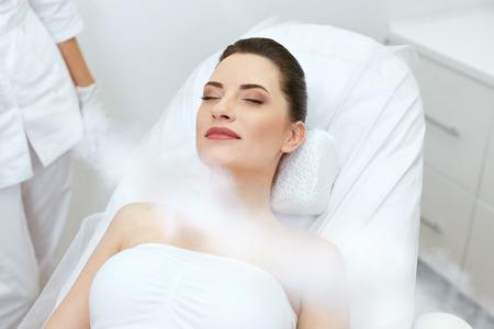 Foto de Cosmetology. Woman At Facial Oxygen Cryotherapy At Beauty Centre. Cryo Treatment On Face. High Resolution - Imagen libre de derechos