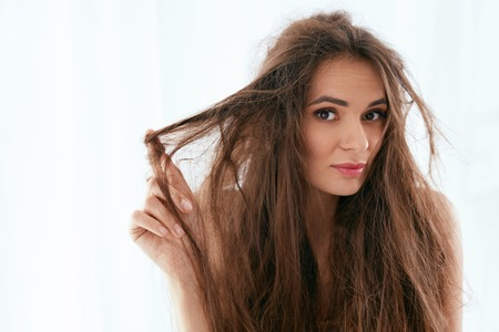 Foto de Hair Problem. Woman With Dry And Damaged Long Hair - Imagen libre de derechos
