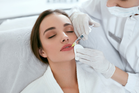 Photo for Lip Augmentation. Woman Getting Beauty Injection For Lips, Facial Beauty Procedure. High Resolution - Royalty Free Image