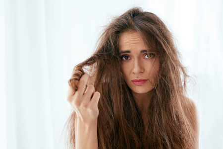 Photo pour Hair Problem. Woman With Dry And Damaged Long Hair, Disheveled And Fluffy Hair. High Resolution - image libre de droit