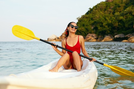 Photo for Summer Vacation. Happy Woman Traveling On Canoe In Sea. Smiling Girl Rowing In Kayak. High Resolution - Royalty Free Image