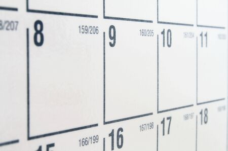 White paper calendar with black numbers and grid