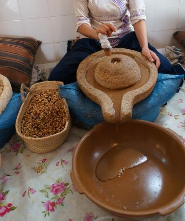 A moroccan worker preparing argan oil.Argan is famous herb in Morocco