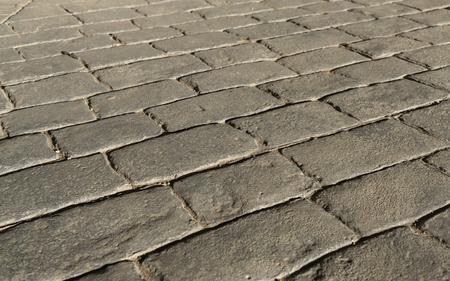 Photo pour Stamped concrete pavement outdoor, mimics cobblestones pattern, flooring exterior, decorative appearance colors and textures of paving cobble stone perspective - image libre de droit