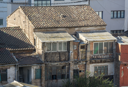 Old and deteriorated back contrafachada house in valencia in a poor and humble neighborhood.