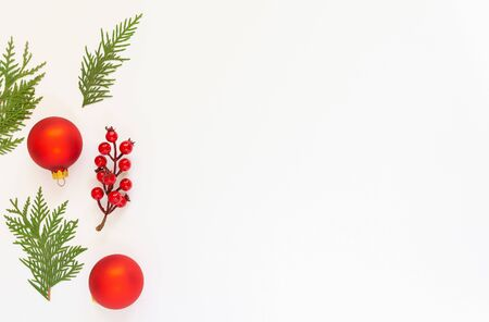 Photo pour Festive background, branch of hawthorn and Christmas tree balls with fir twigs on a white background, flat lay, top view, copy space - image libre de droit