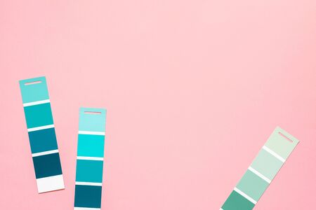 Photo pour Selection of palette for painting, sample color catalog on a pink background, different shades of pink and green colors - image libre de droit