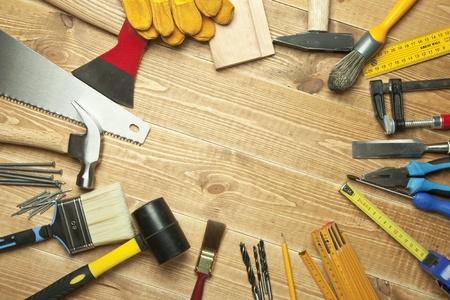 Photo pour Different tools on a wooden background. - image libre de droit