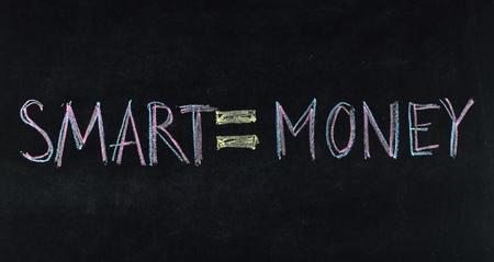 smart and money concept written on blackboard