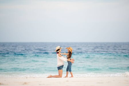Photo for Mother and daughter playing on the beach - Royalty Free Image
