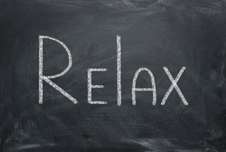 Photo pour Relax - inscription in chalk on a blackboard. Relax concept. - image libre de droit