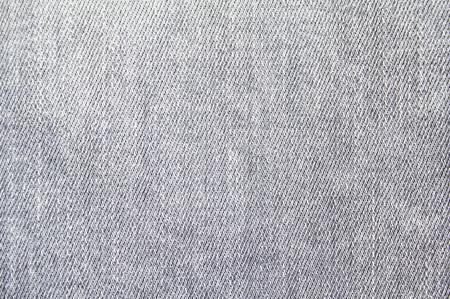Photo pour Closeup grey jeans denim textile texture background. - image libre de droit