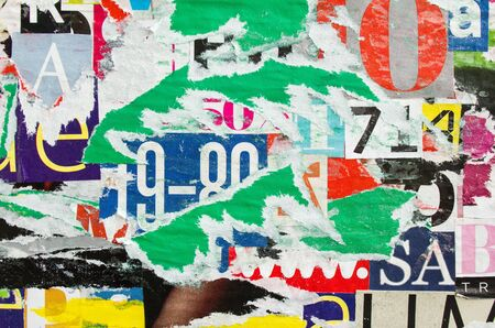 Foto de Torn and peeling crumpled old paper posters and placards with dirty glue stains. Colorful collage from clippings with letters and numbers texture background. - Imagen libre de derechos
