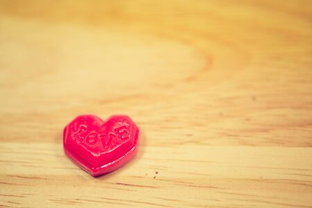 Red love valentine heart on wooden background
